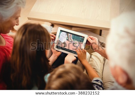 View of lecture app against family using tablet - stock photo