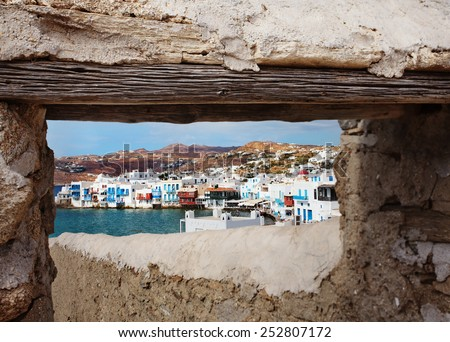 View of Little Venice, in Mykonos, through old doorway. - stock photo