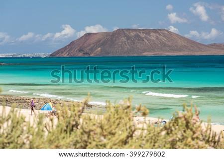 View of Lobos island from Beach in Corralejo, Fuerteventura, Canary Islands, Spain - stock photo