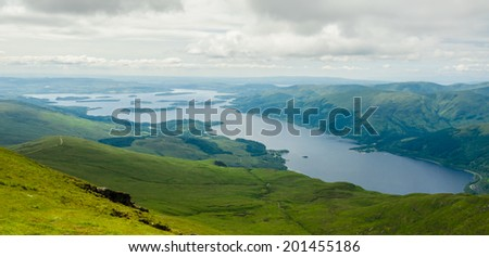 View of Loch Lomond from the top of Ben Lomond in a sunny  day. Scotland (UK). - stock photo