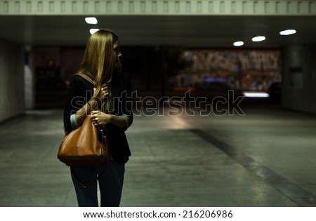 View of lonely woman in the underpass - stock photo