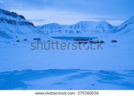 View of Longyearbyen from the mountains. The polar night in March. Spitsbergen (Svalbard). Norway - stock photo