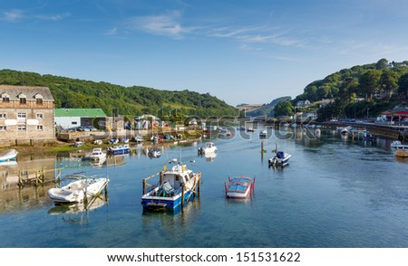 View of Looe harbour and river Cornwall England from the bridge, with blue sea on a sunny summer day  - stock photo