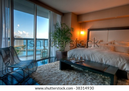 View of luxury apartment bedroom with view to the bay. - stock photo