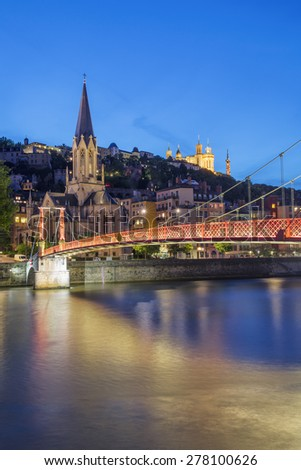 View of Lyon and red footbridge at night, France. - stock photo