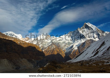 View of Machhapuchchhre mountain at sunset - Fish Tail in English is a mountain in the Annapurna Himalya, Nepal - stock photo
