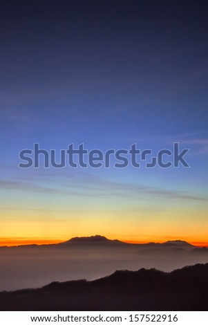 View of magnificent mountain in Java Indonesia taken after sunrise - stock photo