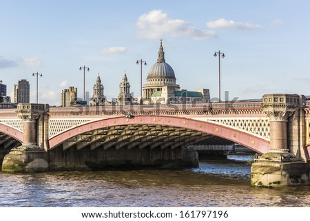 View of magnificent St. Paul Cathedral from Thames at sunset. It sits at top of Ludgate Hill - highest point in City of London. Cathedral was built by Christopher Wren between 1675 and 1711. - stock photo