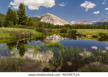 View of majestic Lembert Dome with water reflection.