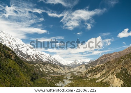 View of Manang Valley, a view from the trail Pisang-Manang, Nepal, Himalayas. Annapurna Circuit Trek, one of the most popular adventure circuit trek in the world. - stock photo