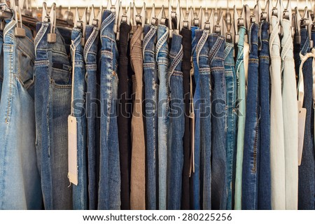 View of many denim jeans in the clothing store - stock photo