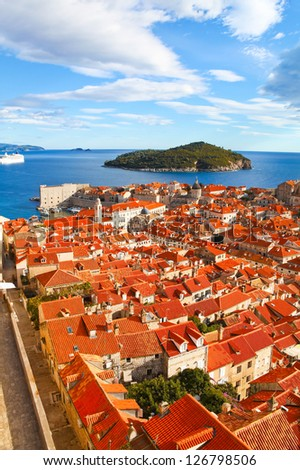 View of many landmarks of Old town in city of Dubrovnik, Croatia. Classic red tiled rooftops with Adriatic sea and island also are beautiful. - stock photo