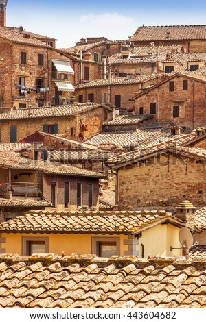 View of many tile roofs of old houses in Siena, Tuscany, Italy. - stock photo