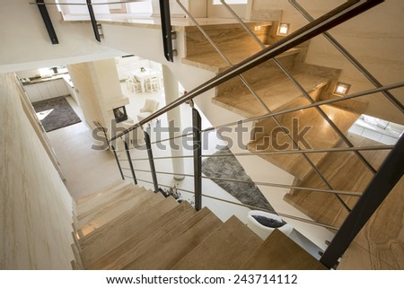 View of marble staircase in expensive house - stock photo