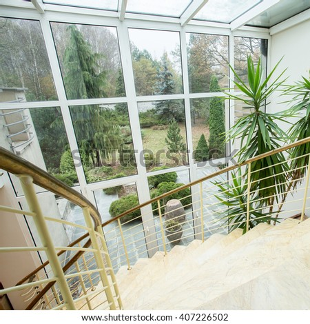View of marble staircase inside expensive house - stock photo