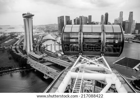 View of Marina Bay and a cabin of a Singapore Flyer black and white - stock photo