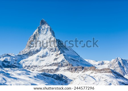 View of Matterhorn on a clear sunny day on the winter hiking path, Zermatt, Switzerland - stock photo