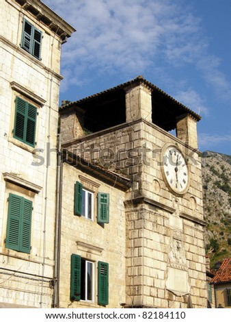 View of medieval clock tower, houses and surrounding mountains, Kotor, Montenegro