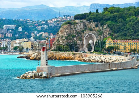 view of mediterranean resort, Nice, Cote d'Azur, France. french riviera. Front of harbor with lighthouse - stock photo
