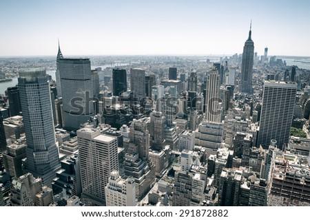 View of Midtown Manhattan New York City skyline on bright summer afternoon - stock photo