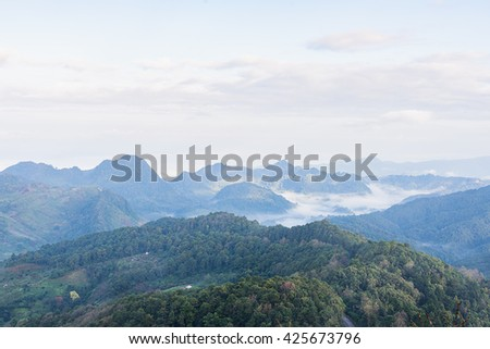 View of mist on the mountain at sunset over mountain range, mountain gap, mountain layer at Doi Ang Khang National Park, chiang Mai, Thailand - stock photo