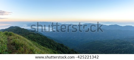View of mist on the mountain at sunset over mountain range, mountain gap, mountain layer at Doi Pha Hom Pok National Park, chiang Mai, Thailand, Panorama view - stock photo