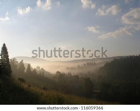 View of misty fog mountains in autumn, Carpathians, Ukraine - stock photo