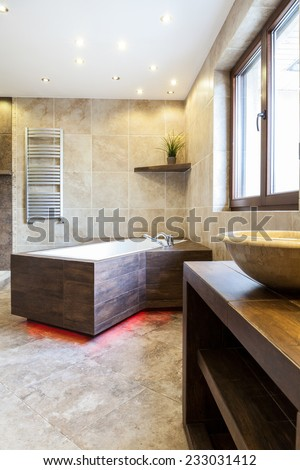 View of modern bathtub in luxury bathroom