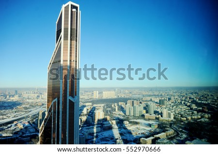 View of Modern glass high-buldings from 56 floor at sunny winter day