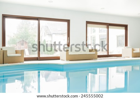 View of modern house with swimming pool - stock photo
