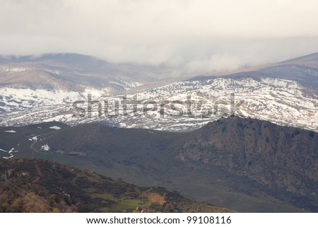 View of Monti Nebrodi with snow and clouds