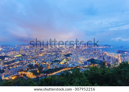 View of most of the urban area in Hong Kong at night, including Kowloon and Hong Kong Island - stock photo