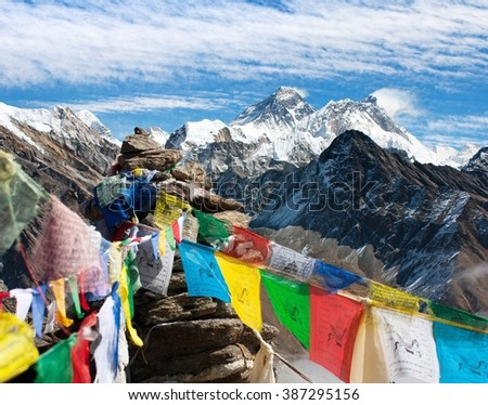view of Mount Everest, Lhotse and Makalu with buddhist prayer flags from Gokyo Ri - Nepal