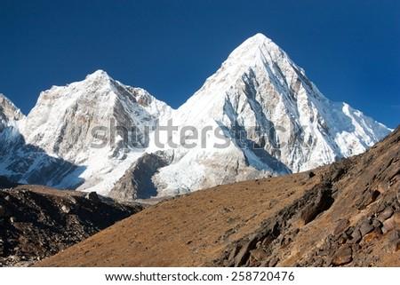 view of mount Pumo Ri near Gorak Shep village and Everest base camp - Trek to Everest base camp - Sagarmatha national park - Nepal - stock photo