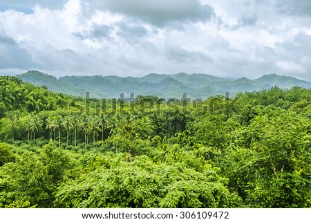 view of mountain with fog in raining season,form balcony at Surat Thani, Thailand - stock photo