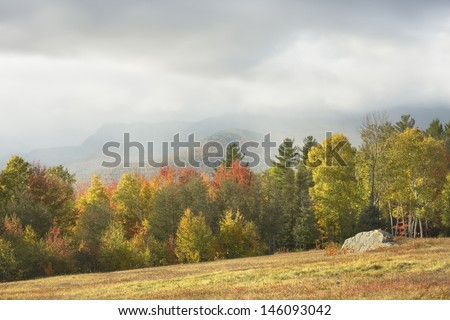 View of mountains and rainstorm in fall, Mount Blue State Park, Weld, Maine. - stock photo