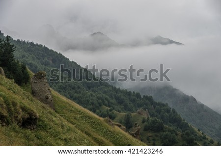 View of mountains in the clouds after storm in valley near Georgian Military Highway. Mtskheta-Mtianeti Region. Georgia, Europe