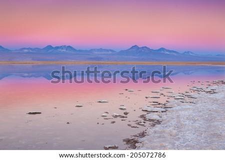 View of mountains reflected in a salt lake near San pedro de Atacama, Chile - stock photo