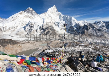 View of Mt. Everest, Lhotse and Nuptse with prayer flags and tourists from Kala Patthar view point near Gorak Shep and Everest base camp, Khumbu valley, Sagarmatha national park, Nepal - stock photo