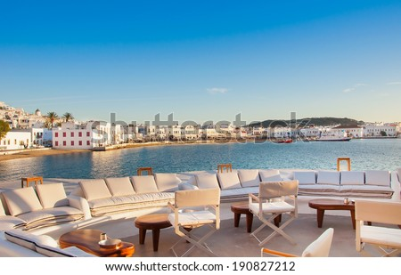 View of Mykonos from restaurant at old port. Greece. - stock photo