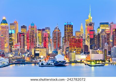 View of New York City at twilight with red sunlight reflection. - stock photo