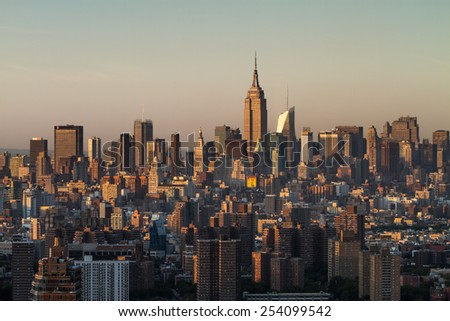 View of New York City from the top of the Brooklyner building during sunset in the summer.