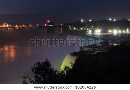 View of Niagara Falls at night in the spotlight