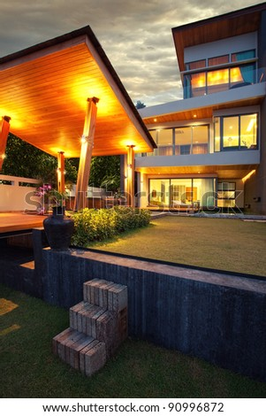 View of nice modern villa in  summer after dark  environment - stock photo