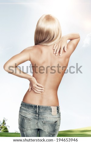 View of nice young woman back on color back