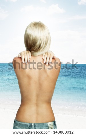 View of nice young wonam back on color back - stock photo