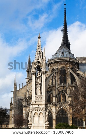 view of notre dame de paris and Fountain of the Virgin from Square Jean XXIII - stock photo