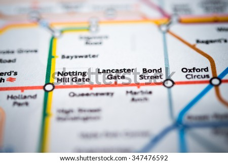 View of Notting Hill Gate, Lancaster Gate and Bond street stations on a London underground map. (vignette) - stock photo