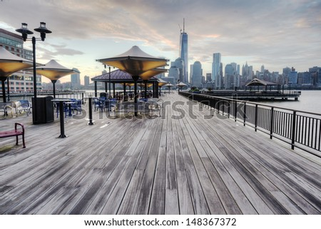 View of NYC from New Jersey Boardwalk. - stock photo