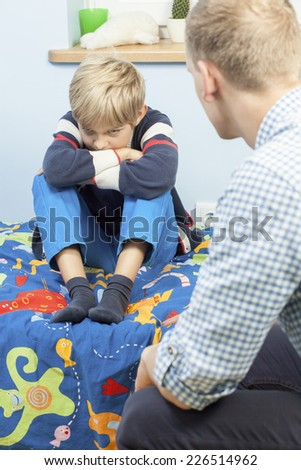 View of offended son in his room - stock photo